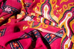 Background texture, pattern. Red maroon fabric. Click on your lo. Cal heritage with this red, bard and yellow striped silk. This patterned fabric will decorate royalty free stock images