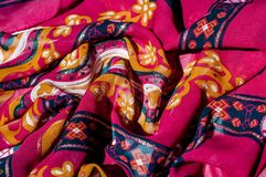 Background texture, pattern. Red maroon fabric. Click on your lo. Cal heritage with this red, bard and yellow striped silk. This patterned fabric will decorate stock photography