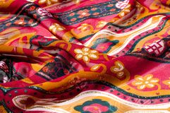 Background texture, pattern. Red maroon fabric. Click on your lo. Cal heritage with this red, bard and yellow striped silk. This patterned fabric will decorate stock photo