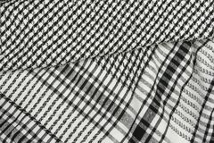 Background texture, pattern. Scarf wool like Yasser Arafat. The Palestinian keffiyeh is a gender-neutral checkered black and white. Scarf that is usually worn royalty free stock photos