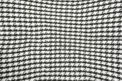 Background texture, pattern. Scarf wool like Yasser Arafat. The Palestinian keffiyeh is a gender-neutral checkered black and white. Scarf that is usually worn royalty free stock photo