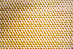 Background texture and pattern of a section of wax honeycomb royalty free stock image