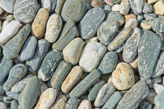 Background texture of pebble stones. In neat lines stock photos