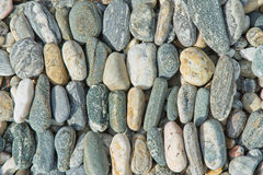 Background texture of pebble stones. In neat lines royalty free stock image