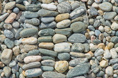 Background texture of pebble stones. In neat lines royalty free stock photo