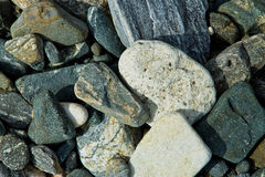 Background texture of pebble stones. In neat lines royalty free stock photography