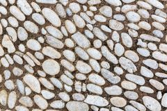 Background texture from a pebbles pavement stock photos