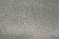 Background and texture photo of gray color wet sand royalty free stock photos