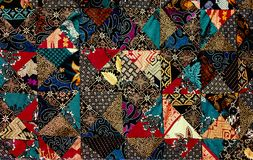 Background texture of pieces of old carpets with stitching thick threads stock image