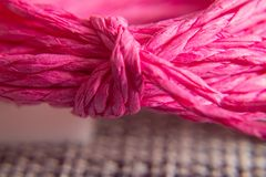 Background texture of pink rope with knot. concept and design royalty free stock image