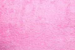 Background with a texture of pink terry cloth. Royalty Free Stock Images