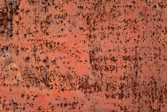 Background, texture: primed metal plate with rust spots. Background, texture: surface of primed metal plate with rust spots and scratches stock photography