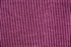 Background texture of purple striped velvet closeup. Background texture of purple striped velvet close up royalty free stock image
