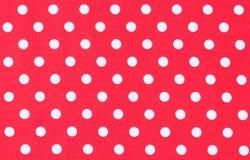 White dots on red fabric, polka dot pattern background texture. Background texture of red fabric with white polka dots pattern, close-up royalty free stock image