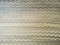 Background or texture of a rippled abstract distortion on a stack of papers. The various shades of paper colors make beautiful patterns Stock Image
