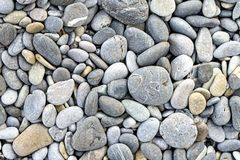 Background texture with round pebble stones. Closeup royalty free stock photo