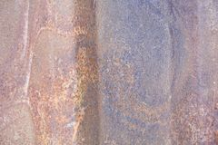 Background texture of rust. Metal sheet of red and orange color, covered with rust. Rough texture. Abstract, aged, brown, damaged, old, stain, grunge, messy stock image