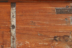 Background texture of rustic weathered wood with rusty metal bar Royalty Free Stock Photos