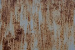Rusty sheet of iron, with traces of paint. stock images