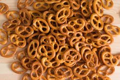 Background texture of salted savory mini pretzels in the traditi. Onal looped knot shape. Top view full frame from overhead Royalty Free Stock Photo