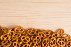 Background texture of salted savory mini pretzels in the traditi. Onal looped knot shape. Top view full frame from overhead Royalty Free Stock Image