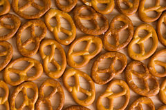 Background texture of salted savory mini pretzels in the traditi Stock Image