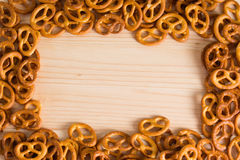 Background texture of salted savory mini pretzels in the traditi. Onal looped knot shape. Top view full frame from overhead Royalty Free Stock Photos
