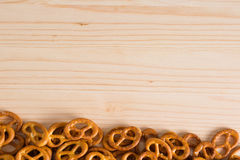 Background texture of salted savory mini pretzels in the traditi. Onal looped knot shape. Top view full frame from overhead Royalty Free Stock Images