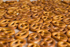 Background texture of salted savory mini pretzels in the traditi Royalty Free Stock Images