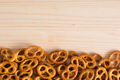 Background texture of salted savory mini pretzels in the traditi. Onal looped knot shape. Top view full frame from overhead Royalty Free Stock Photography