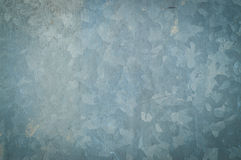 Background texture of a sheet of galvanized metal coated with a layer of zinc Stock Image