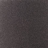 Background texture of a shiny metal sheet with a rough stippled textured surface reflecting light. Metal texture Stock Photos