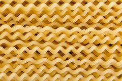 Background texture of spiral fusili Italian pasta. Background texture of dried uncooked spiral fusili Italian pasta with its distinctive corkscrew shape in a royalty free stock image