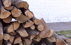 Background texture of stacked armfuls of dry firewood. Side view, cropped shot, horizontal, close-up, space for text right. Concept of nature stock images