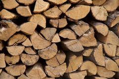 Background texture of stacked dry firewood. Side view, cropped shot, horizontal, close-up. The concept of nature royalty free stock photography