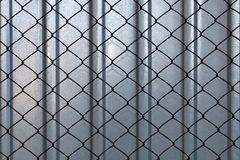 Background, texture of steel fence with rusty mesh. royalty free stock images