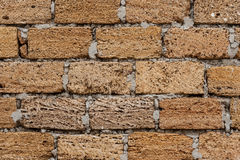 Background. The texture of the stone wall. Coquina material fastened with cement mortar Stock Image