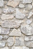 Background, texture stone wall over the whole frame. Vertical frame Royalty Free Stock Images