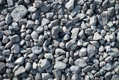 Background texture stones. shadow and light play with stones on the road royalty free stock photography