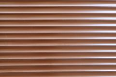 Background, texture. Surface of brown metal blinds. stock images