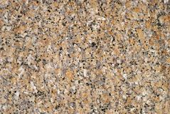 Background, texture - surface of granite block. Background, texture - gray and white granite surface with orange spots Stock Photography