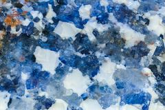 Background, texture - the surface of the mineral halite. Background, texture - white and blue surface of halite mineral, natural crystalline rock salt stock photos