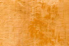Background texture of a terra cotta colored wall Royalty Free Stock Photo