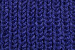 Background texture is a tricate cloth, knitting and loops. / Royalty Free Stock Photography