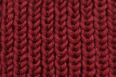 Background texture is a tricate cloth, knitting and loops.  Stock Images