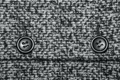 Background texture of twill with two big black buttons Stock Photography