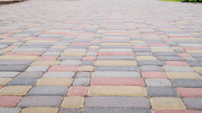 Background, texture of urban multicolored pavers on the whole frame. Horizontal frame Stock Images