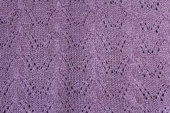Background texture of violet pattern knitted fabric made of cott Stock Photo