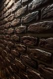Background texture of a wall with a brick decor. Close-up royalty free stock photo