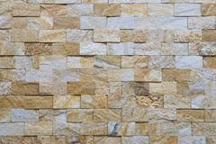 Wall made of natural square stones Stock Photo